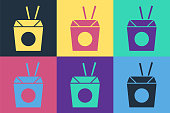 istock Pop art Asian noodles in paper box and chopsticks icon isolated on color background. Street fast food. Korean, Japanese, Chinese food. Vector 1271981329