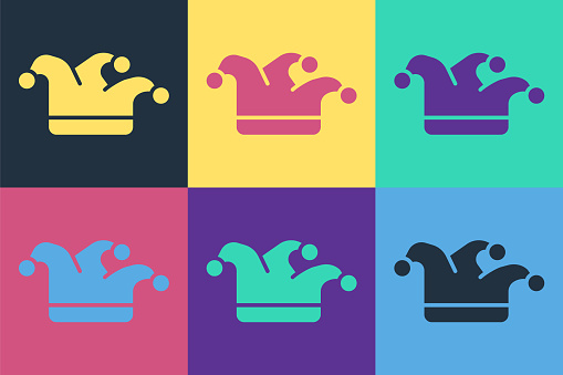 Pop art Joker playing card icon isolated on color background. Jester hat with bells. Casino gambling. Vector Illustration