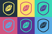 Pop art Shield with leaf icon isolated on color background. Eco-friendly security shield with leaf. Vector Illustration