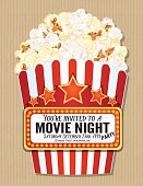 Popcorn Box Movie Night Invitation Template. Cute popcorn box filled with fluffy popcorn. On the front is a lighted marquee with space for text.