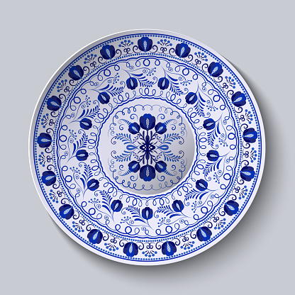 Porcelain plate with blue round ornament in ethnic style. Decorative pattern in the style of national flower painting. Ornate floral decor. Realistic 3D decor.