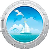 Porthole with sea landscape, yacht and seagull