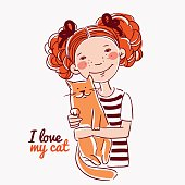Portrait of a cute girl with a cat. Child and Pet