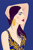 Portrait of a girl with black long hair and large earrings. Pretty woman with bright makeup on a blue background. Flat vector illustration. Fashion model pose, beauty look.