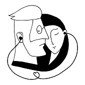 Portrait of couple who listen to music by one pair of headphones for two