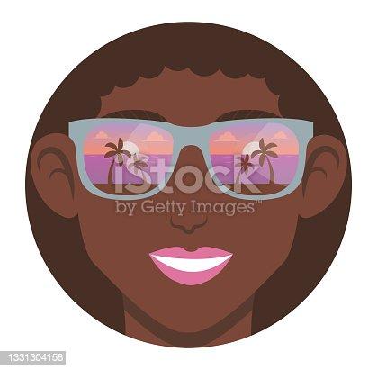 istock Portrait of smiling girl in sun glasses. 1331304158