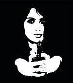 Portrait of young dangerous female spy aiming gun at camera