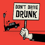 Poster in hand with car crash and text Don't Drive Drunk