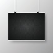 Realistic poster in horizontal position and with an carbon metallic background (carbon fiber texture), isolated on white background.