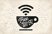 Poster with cup of coffee and text Free WiFi for street cafe. Sign free wifi area sign on a coffee cup. Black and white design with lettering. Vector Illustration