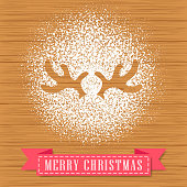 Decorate a reindeer antler shape with powdered sugar on hardwood background for Christmas