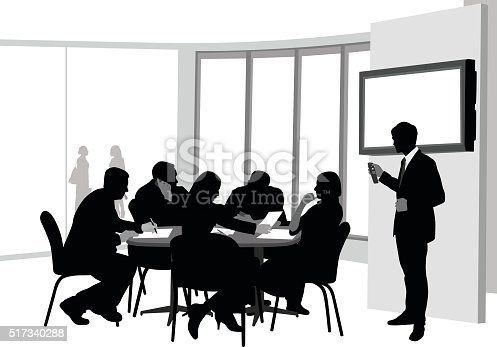A vector silhouette illustration of a presentation to board room meeting amongst business men and women sitting a table with documents.  A young man stands in front of a monitor holding a remote control.