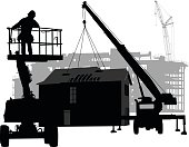 A vector silhouette illustration of a prefabricated building being placed by  a crane with a safty barrier around it.  A partitially constructed building is in the background.  A man drives a boom lift on the side.