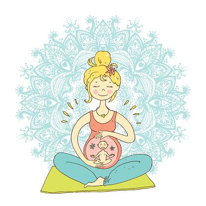 pregnant woman in lotus position against mandala