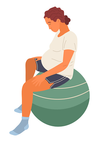 Pregnant woman sits on fitness ball with head bowed. Relaxation exercises for pregnant women