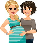 A happy pregnant woman standing with a supportive doula or midwife.
