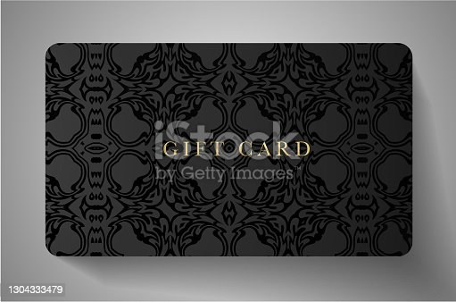 istock Premium Gift card with vintage curve ornament (pattern) on black background 1304333479