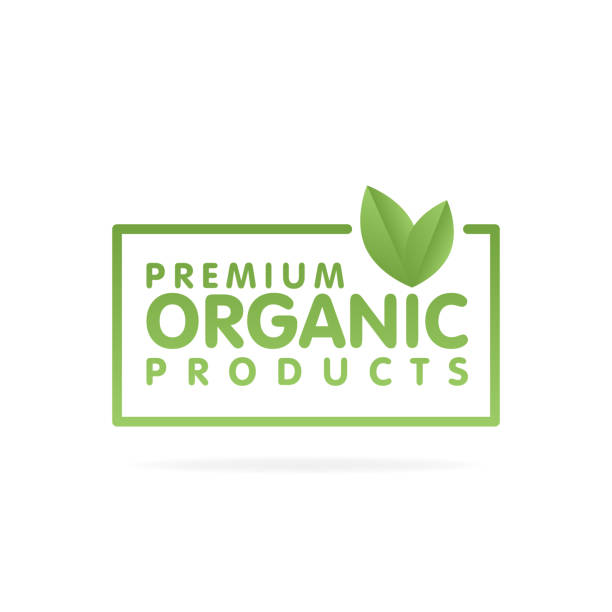 Premium organic products banner. Text and frame with green leaf. Vector illustration Premium organic products banner. Text and frame with green leaf. Vector illustration. organic farm stock illustrations