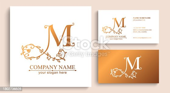istock Premium Vector M logo. Monnogram, lettering and business cards. Personal logo or sign for branding an elite company. 1302736525