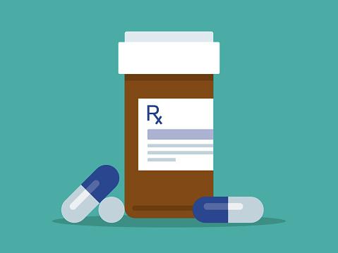 Prescription pill bottle and pills