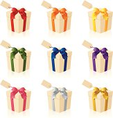 Gift boxes and tags with different coloured ribbons.
