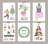 Pretty decorative rectangular Christmas labels set with six different designs of an Xmas tree, wreath, bird with christmas tree, ice skater and gift boxes on a grey background