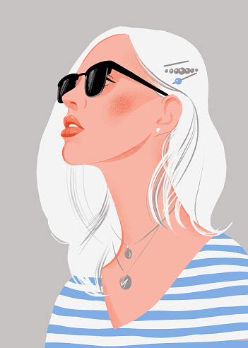 Pretty young woman with blonde hair and sunglasses. Female portrait.