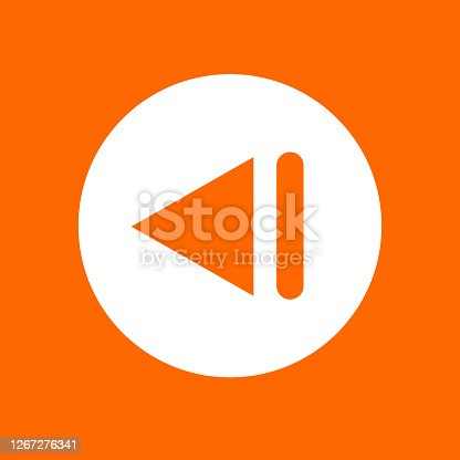 istock Previous track sign icon. In white circle on a orange background 1267276341