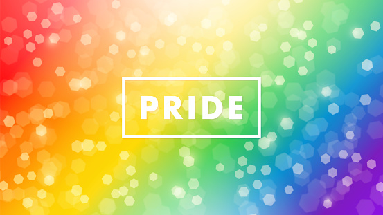 Pride sign with frame over a colorful bokeh rainbow background for LGBTQ rights and movements concept.