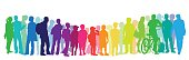 A vector silhouette illustration of a large group of young adults and children coloured in a vibrant rainbow.