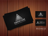 Professional business or visiting card presentation on wooden background.