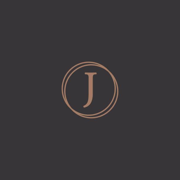 Professional letter J in rounded design frame logo Simple professional letter logo design in a stylish rounded frame in a black background. letter j stock illustrations
