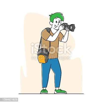 istock Professional Photographer with Photo Camera and Bag on Shoulder Making Picture. Cameraman Expert Job, Creative Hobby 1284621825