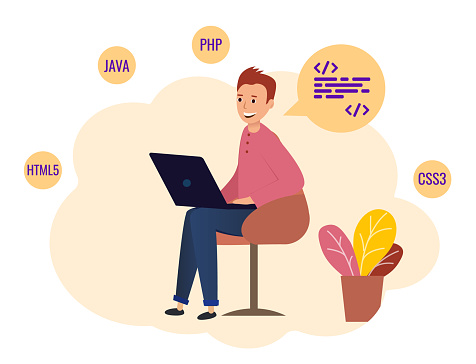 Programmer sitting with laptop and working.
