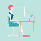 Proper posture for sitting at an office desk. Diagram shows a woman typing at her desk with an ergonomic footrest.
