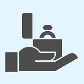 Proposal solid icon. Ring in box on hand, man offering marriage for lady. Wedding asset vector design concept, glyph style pictogram on white background, use for web and app. Eps 10