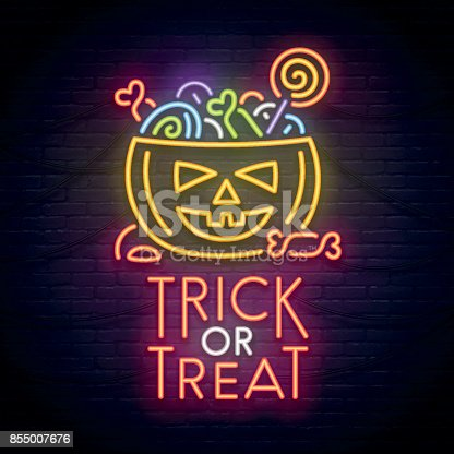 istock Pumpkin and candy neon sign. Happy Halloween. Neon sign, bright signboard, light banner. 855007676