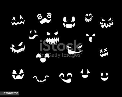 istock Pumpkin cut creepy faces set 1270707538