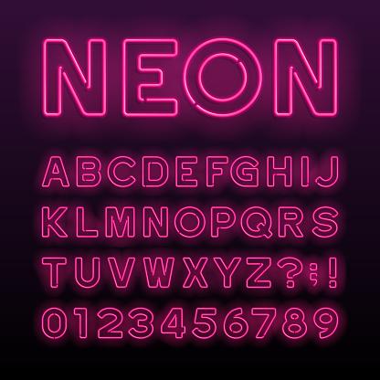 Purple neon tube alphabet font. Neon color letters.