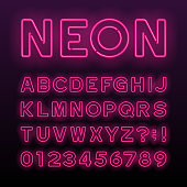 Purple neon tube alphabet font. Neon color letters.