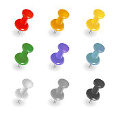 Set of push pins in different colors. Thumbtacks. Top view. Vector illustration. Isolated on white background.