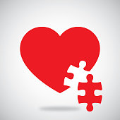 Vector illustration of a red heart with puzzle piece cutout against a grey background.