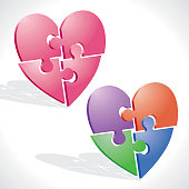 Vector illustrations of two optional elegants colored Puzzles forming hearts.