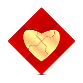 Puzzle with the image of a gold  heart on a red background
