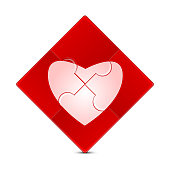 Puzzle with the image of a pink heart on a red background