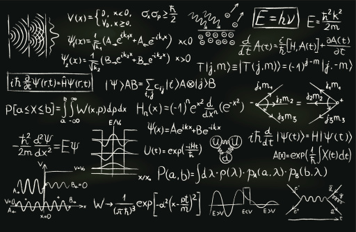 Formulas and sketches related to quantum physics written on a blackboard.