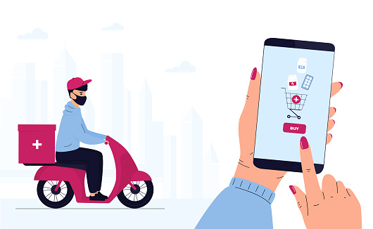 COVID-19. Quarantine. Coronavirus epidemic. Delivery man in a protective mask delivers parcel by motorbike. Hand is holding smartphone to buy pills. Order Medicines Online. Medicament shipping.