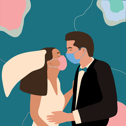 Quarantine coronavirus wedding.Man and woman in love, get married. Couple kissing with face masks