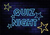 istock Quiz Night Sign Blue Neon Light On Dark Brick Wall 1217380204
