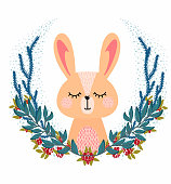 Vector illustration with cute animal. Rabbit head in a christmas round frame of berries and leaves